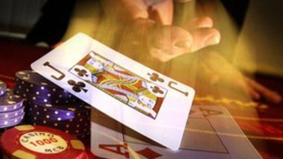 Poker table, chips, playing card