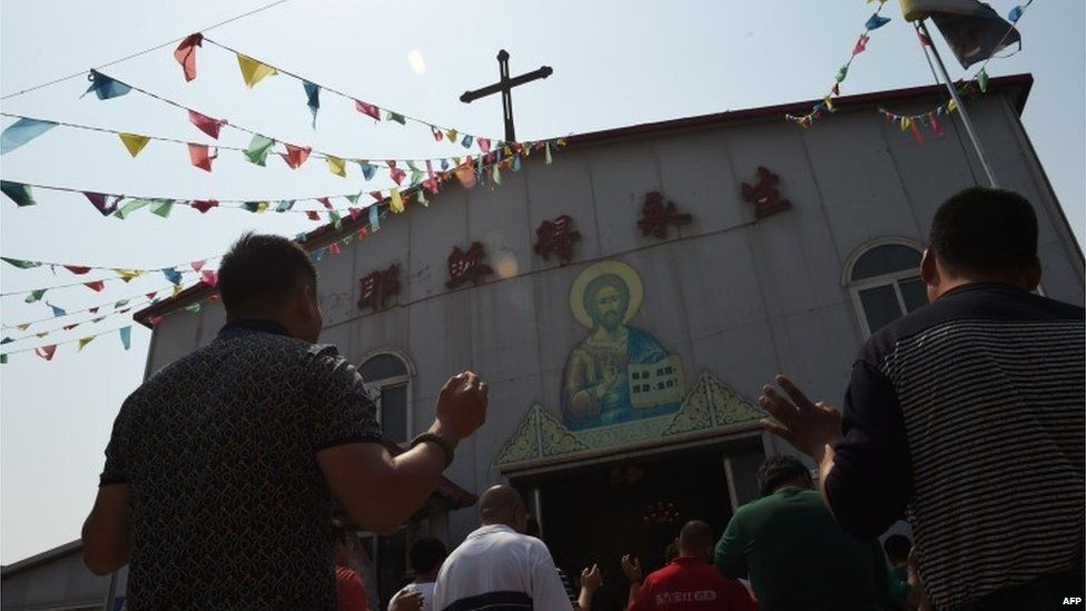 """This photo taken on May 24, 2015 shows worshippers celebrating the Feast of the Ascension at the """"underground"""" Zhongxin Bridge Catholic Church in Tianjin. Tianjin,"""