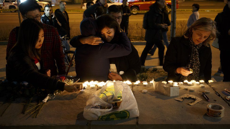 Mourners leave candles and messages on Yonge Street after Monday's attack