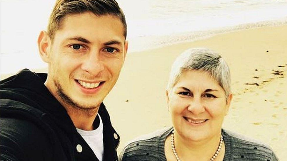 Picture of Emiliano Sala and his mother Mercedes on a beach. It was the last time she saw her son
