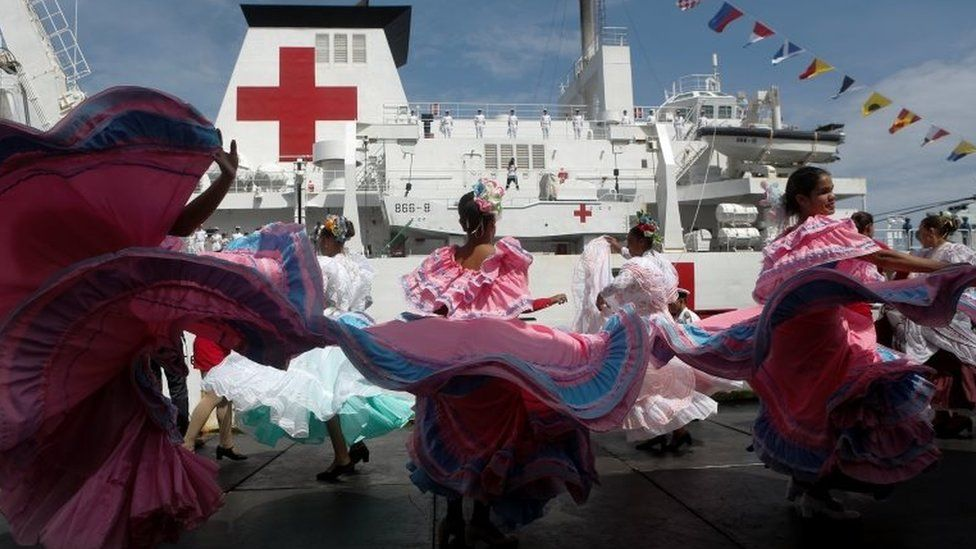 Members of the Chinese People Liberation Army Navy stand at the hospital ship Peace Ark at the port in La Guaira, Venezuela 22 September 2018