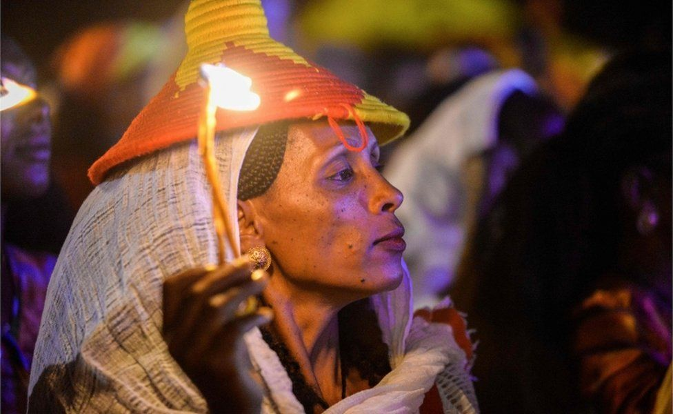 """An Ethiopian holds a candle during a lighting ceremony on the eve of the 45th anniversary of the launching of the """"Armed Struggle of the Peoples of Tigray"""", on 18 February 2020 at Mekelle city."""