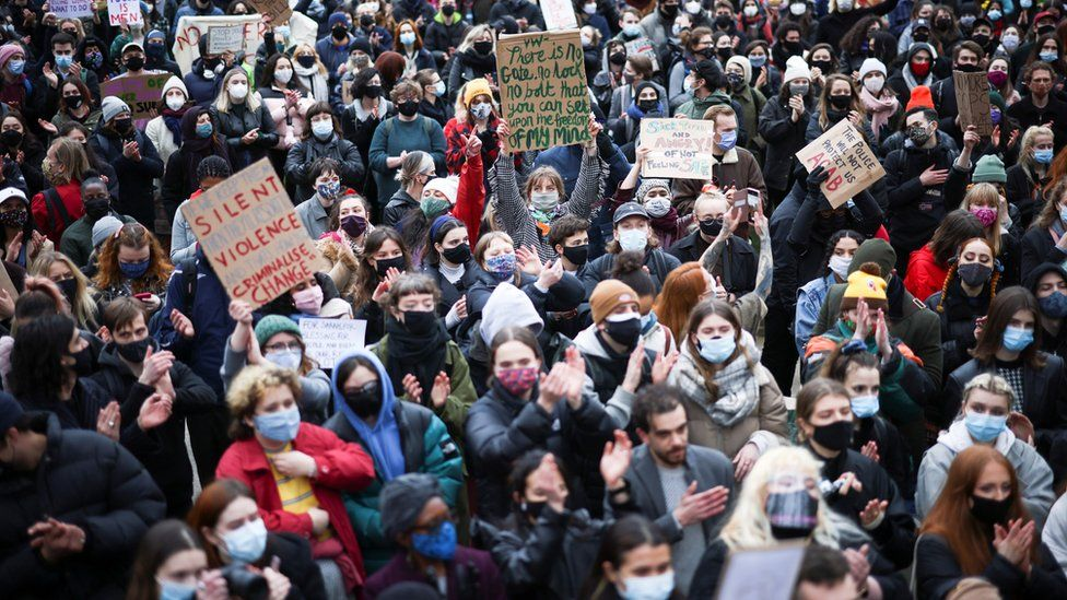 People attend a protest at Parliament Square, central London