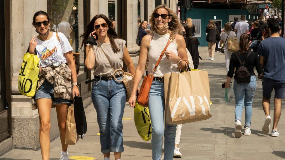 Shoppers on Oxford Street in July