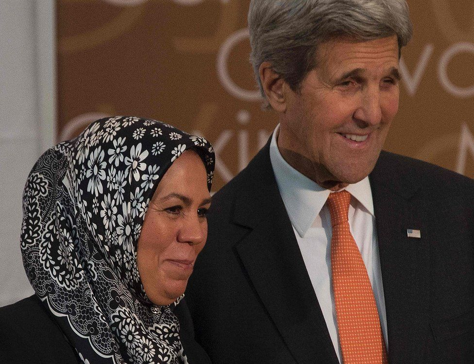 French recipient of the 2016 International Women of Courage Award, Latifa Ibn Ziaten (L), poses with US Secretary of State John Kerry at the State Department in Washington, DC, March 29, 2016
