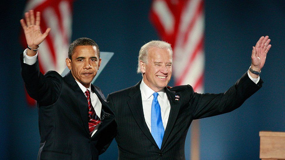 Barack Obama and Joe Biden wave to their supporters after Obama gave his victory speech during an election night gathering in Grant Park on November 4, 2008