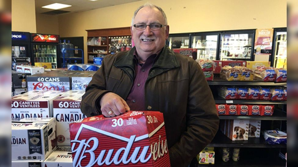 Gerard Comeau buying beer in Quebec after his 2016 court win