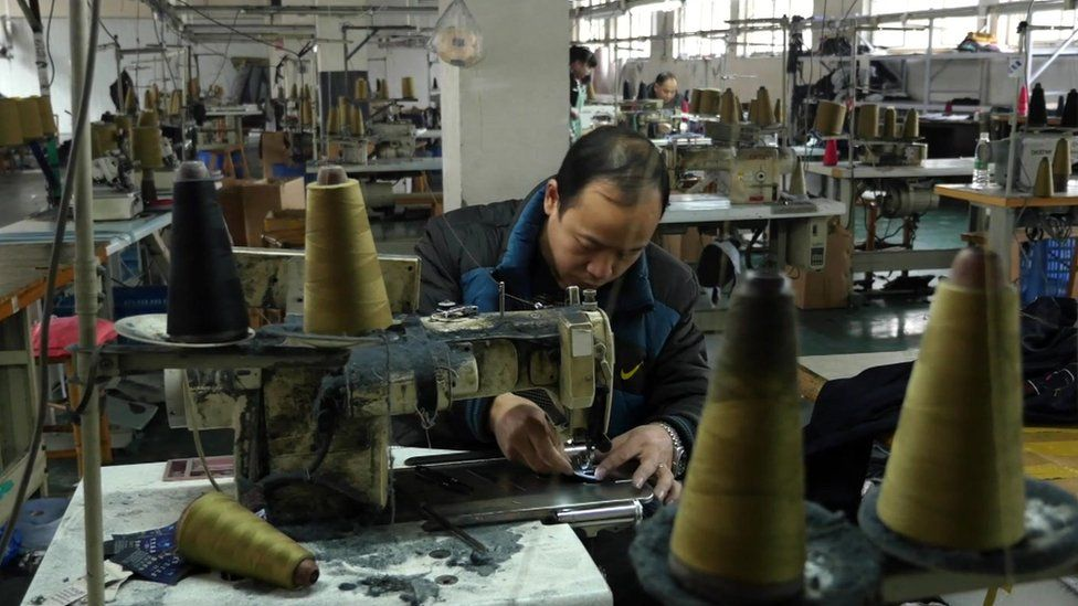 Tang Yujun working at his factory in Chengdu