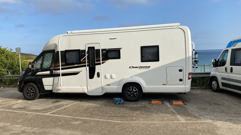 Motor home parked across three spaces