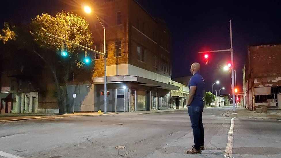 Brian Rice looking at empty buildings