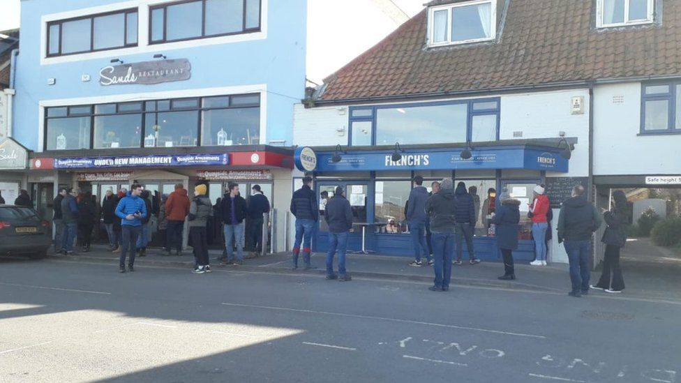 People outside fish and chip shop in Wells-next-the-Sea