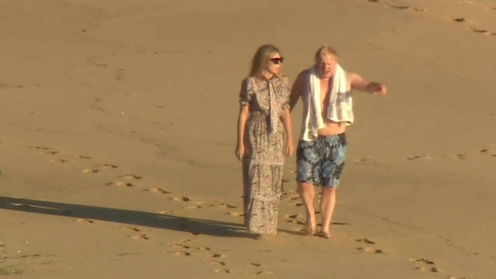 Boris and Carrie Johnson on beach at Carbis Bay