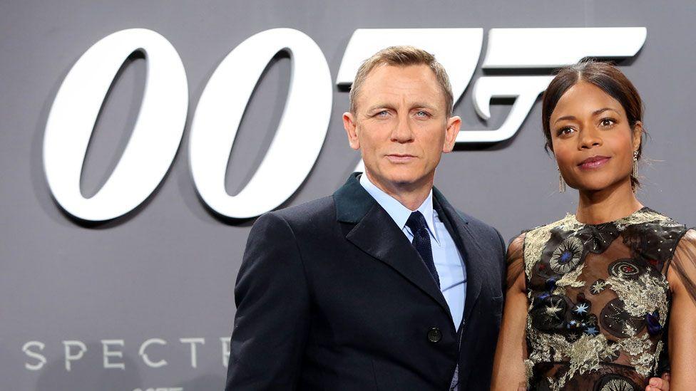 Naomie Harris with Daniel Craig