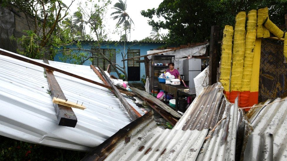 A woman stands amidst the debris of her home which was destroyed when Hurricane Grace slammed into the coast with torrential rains, in Costa Esmeralda, near Tecolutla, Mexico, 21 August 2021