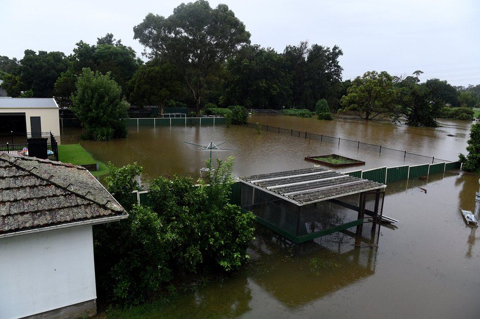 Floodwater completely submerges the backyards of properties on Ladbury Ave, in Penrith, New South Wales, Australia, 21 March 2021.