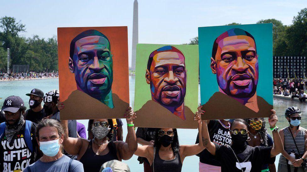Demonstrators listen to speakers near the Lincoln Memorial