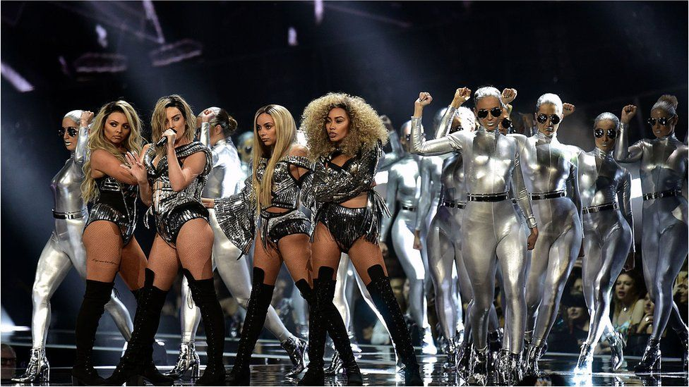 Little Mix opened the show with a silver themed performance