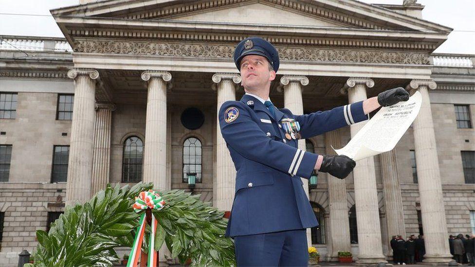 Irish Air Corps' Captain Sean McCarthy reads the Irish proclamation