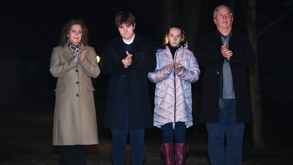 """Captain Sir Tom Moore""""s daughter Hannah Ingram-Moore, grandson Benji, granddaughter Georgia and son-in-law Colin Ingram outside his the home in Marston Moretaine"""