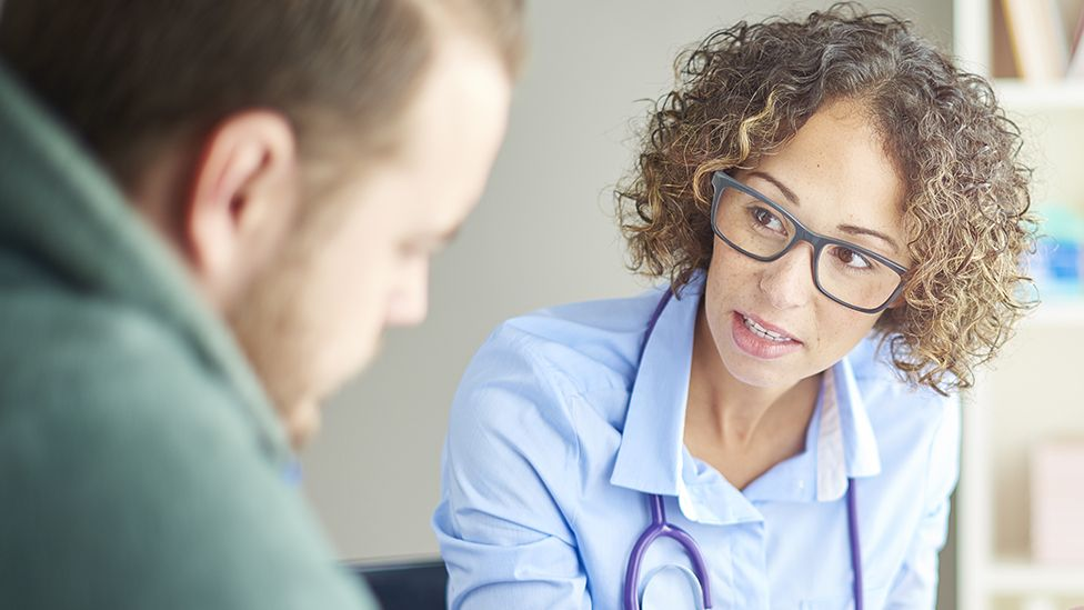 Stock image of a doctor talking to a patient