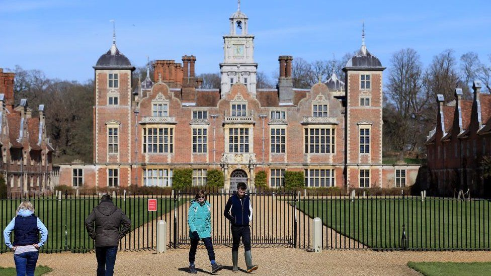 Visitors are seen at Blickling Hall and Estate, in Norwich, which has been closed by the National Trust to help fight the spread of coronavirus