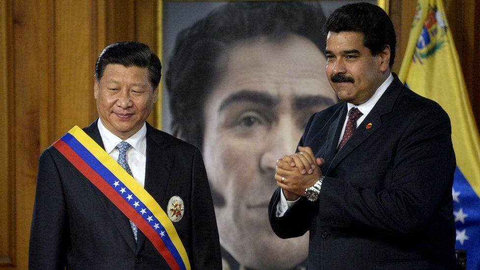 Venezuelan President Nicolas Maduro and China's President Xi Jinping , wearing a Venezuelan sash