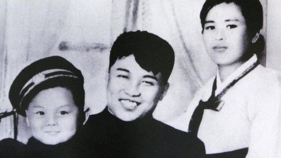 An undated North Korean propaganda picture, claiming to be North Korean founder Kim Il-sung (C), his first wife Kim Jong-suk and his son Kim Jong-il, displayed at a high school in Seoul.