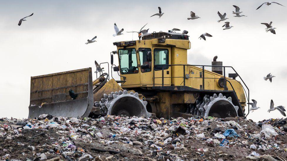 A digger at landfill