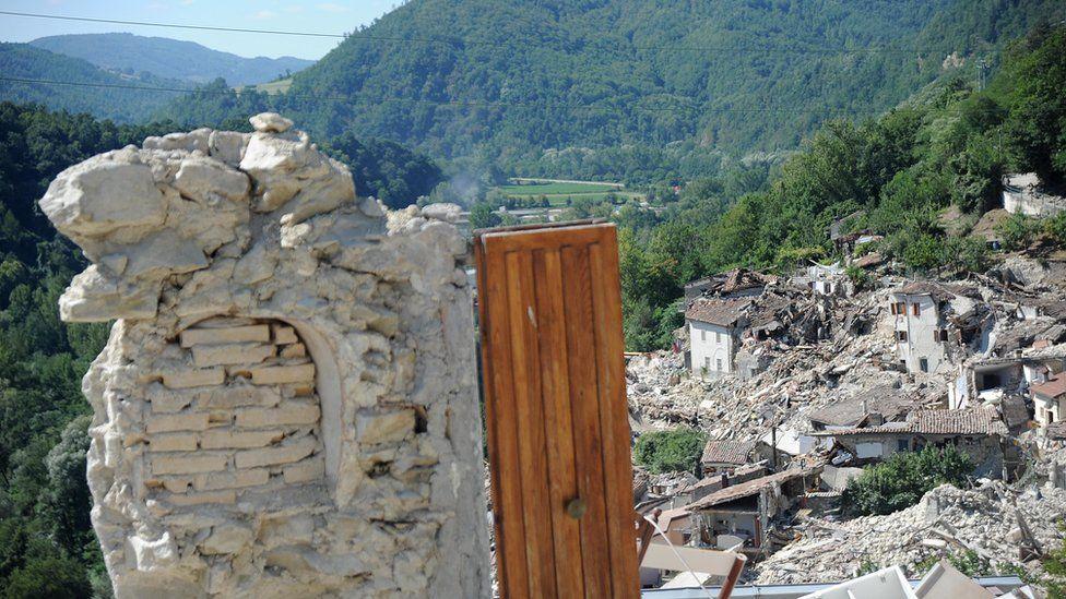 A door of a destroyed building in Pescara del Tronto, Italy