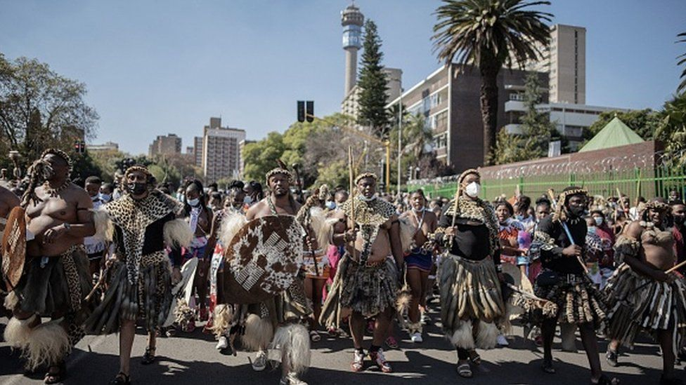 More than 200 Zulu traditionally dressed people parade through the streets in Johannesburg