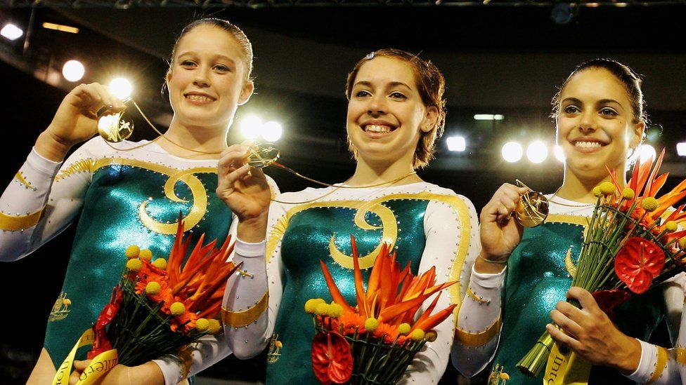 (L-R) Naomi Russell, Chloe Sims, and Monette Russo of Australia celebrate winning Gold in the Womens Artistic Gymnastics at the 2006 Commonwealth Games