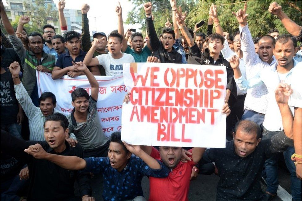 Students shout slogans during a protest against the Citizenship Amendment Bill (CAB) in Guwahati, Assam, India, 11 December 2019
