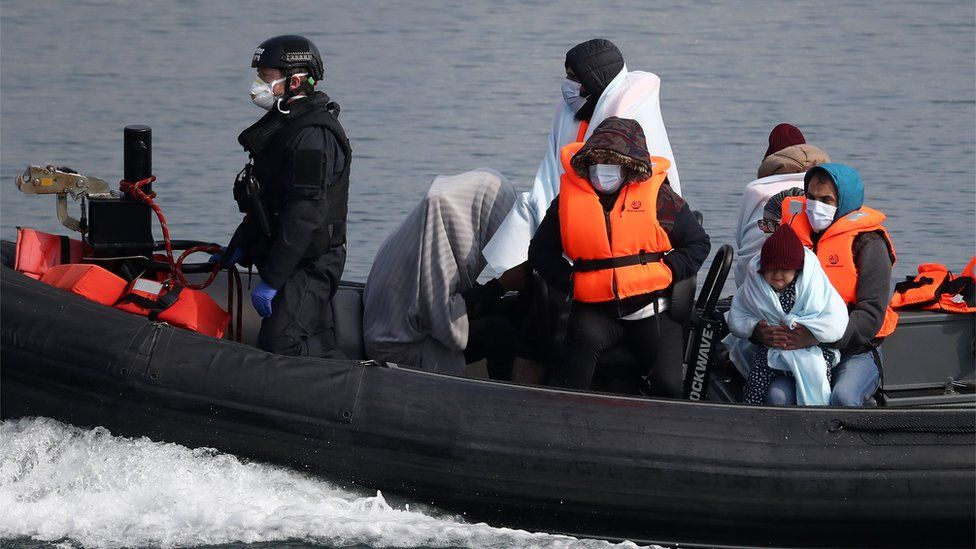 A group of people thought to be migrants are brought in to Dover, Kent, by Border Force officers following a small boat incident in the Channel
