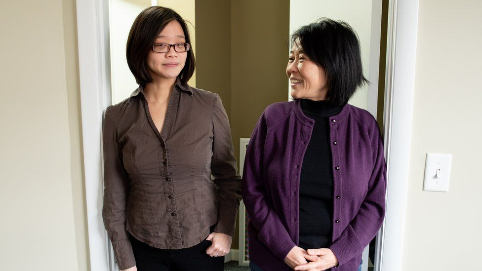 Eiling Chao, shown with her daughter Stephanie, standing in a doorway