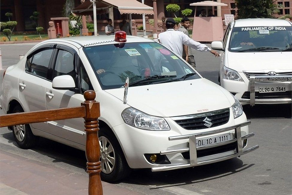 """This file photo taken on May 8, 2015 shows an Indian politician""""s car with a red beacon on it outside Parliament House in New Delh"""