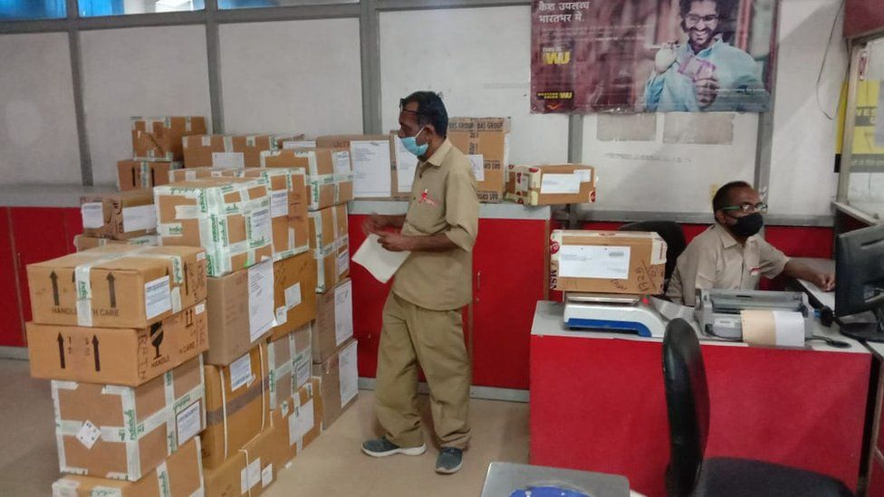 Postal workers sorting medical consignments
