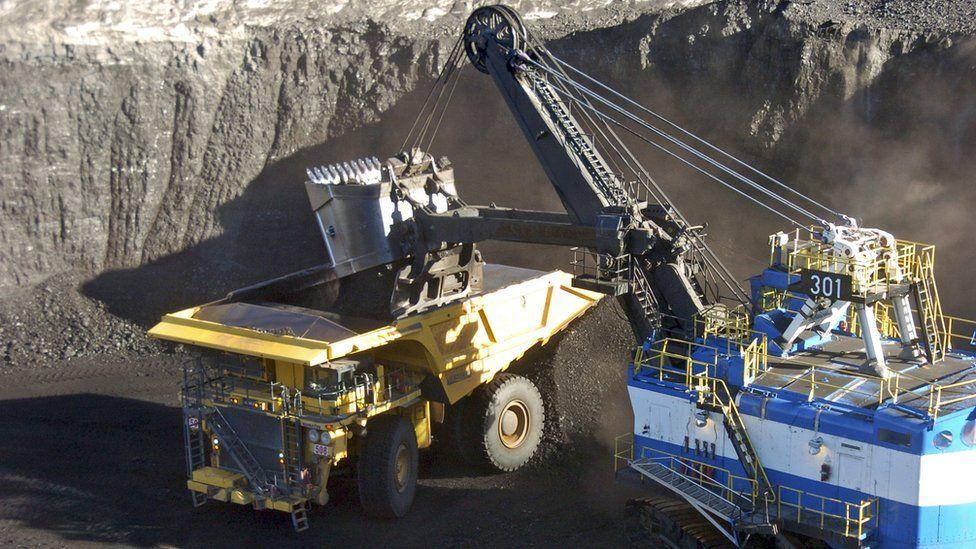A mechanized shovel loads coal from an 80-feet thick seam into a haul truck at Cloud Peak Energys Spring Creek mine near Decker, Montana, November 2016