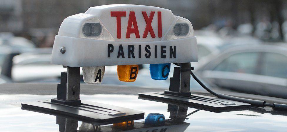 Paris taxi sign, file pic