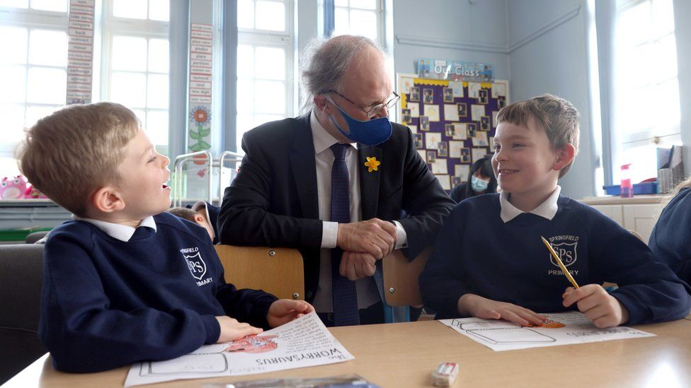 Education Minister Peter Weir in a classroom with two schoolboys