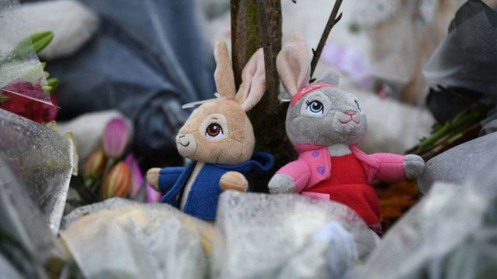 Soft toy tributes at scene of fire