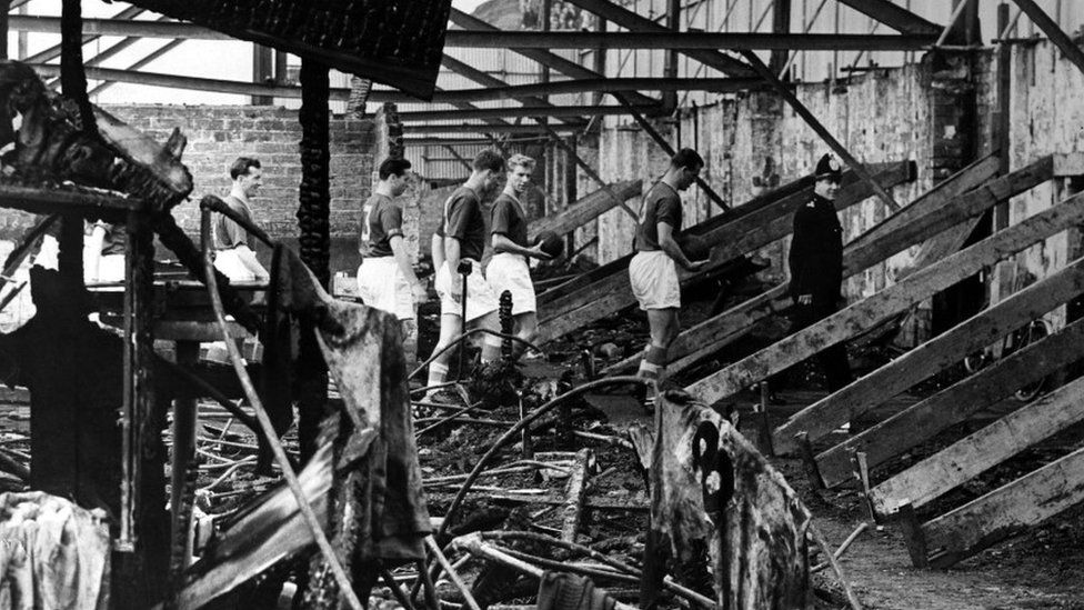 Leeds United Team surveying fire damage