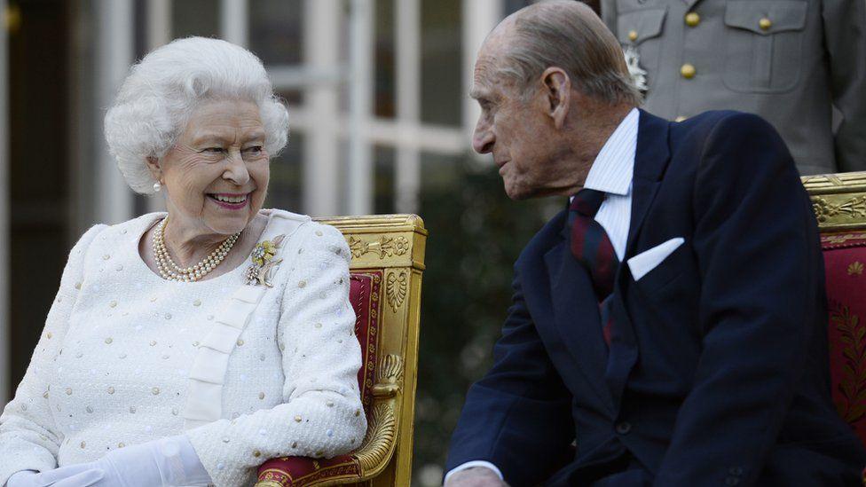 Queen Elizabeth II and the Duke of Edinburgh attending a garden party in Paris