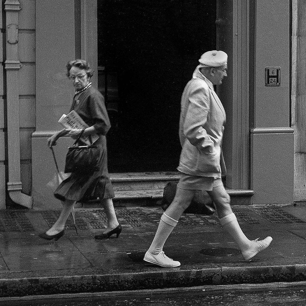 Woman glancing at Scottish gentleman, London 1956