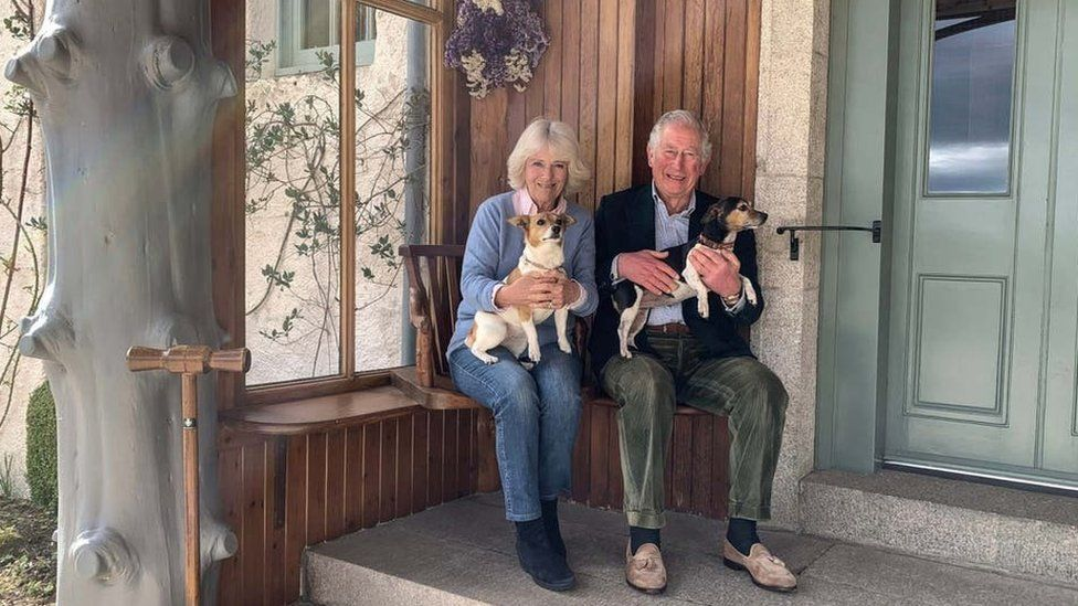 Camila and Prince Charles holding their dogs