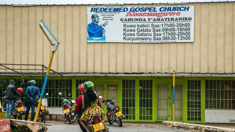 Motorcycle passes the closed entrance to the 'The Redeemed Gospel Church' is in Kigali, Rwanda, on March 1, 2018
