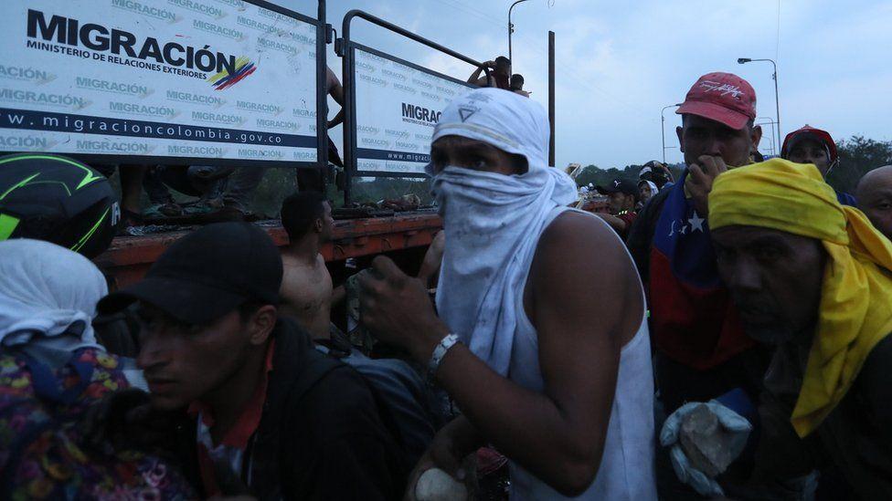 Demonstrators clash with Venezuelan police on the Francisco de Paula Santander bridge on the border Colombia, and Venezuela. Photo: 23 February 2019