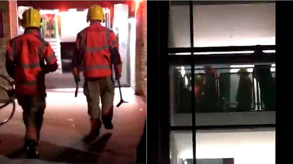 Firefighters freeing trapped students