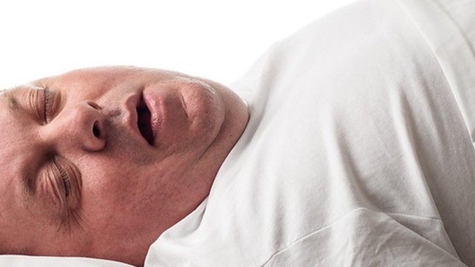 Overweight man asleep