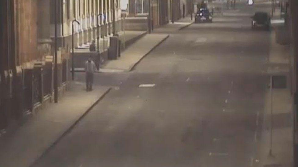 Samuel Fortes walking along a Leeds street