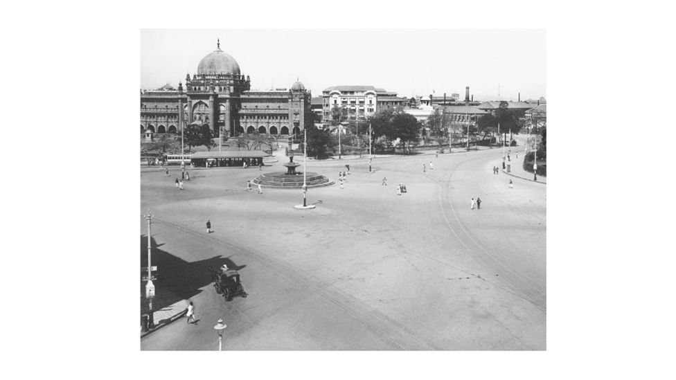 A black and white archival image of the Wellington Fountain in South Mumbai.